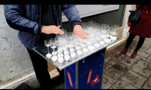 Man rubs his fingers around a bunch of glasses—sound that comes out, you definitely know what it is