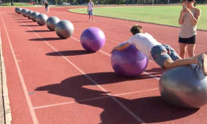 Man attempts to go 'surfing' on a bunch of exercise balls—I've never seen anybody do this before
