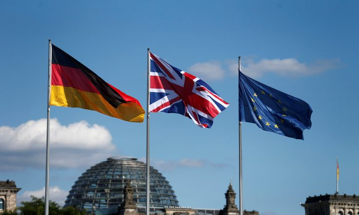 German, British and European Union flags fly in front of the Reichstag building in Berlin, Germany July 20, 2016. (Reuters/Hannibal Hanschke/File Photo)