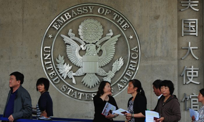 Chinese citizens wait to submit their visa applications at the U.S. Embassy in Beijing, China on May 2, 2012. (Mark Ralston/AFP/GettyImages)