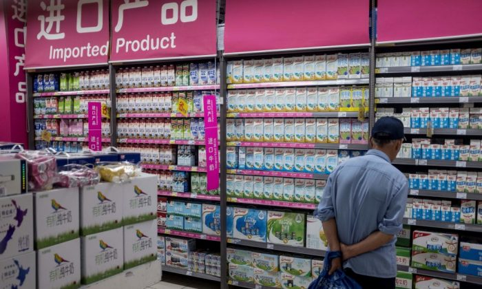 A man looks at imported products at a supermarket in Shanghai on April 11, 2018.