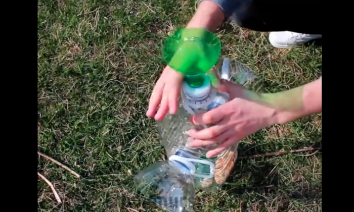 Man cuts open an old soda bottle, within minutes—it starts catching fish