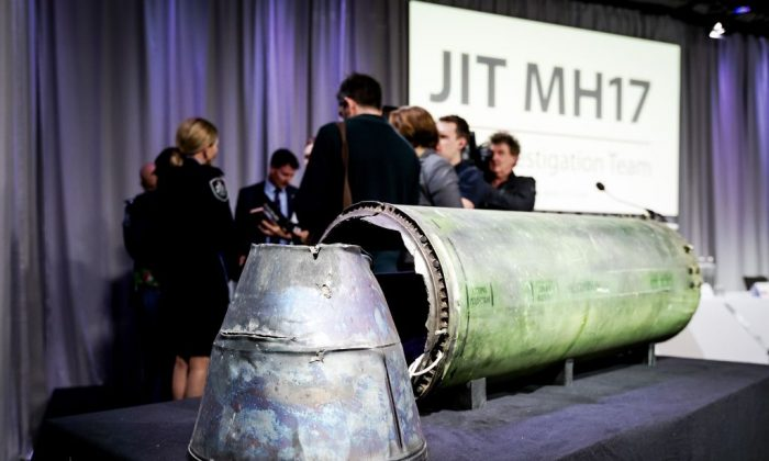 A part of the BUK-TELAR rocket that was fired on the MH17 flight is displayed on a table during the press conference of the Joint Investigation Team (JIT), in Bunnik on May 24, 2018. (Robin Van Lonkhuijsen/AFP/Getty Images)