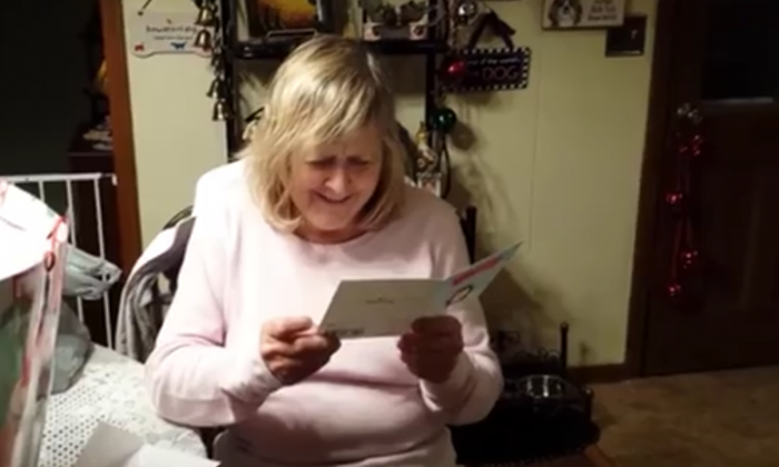 She's told to read this card on Christmas, but then the real present comes—she's screaming
