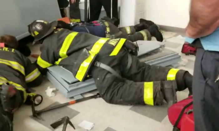 Man doing construction work gets stuck under metal cabinet—then firefighters step in