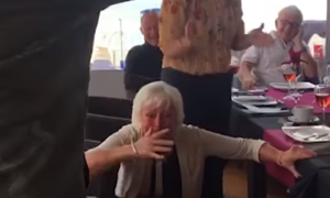 Mom on vacation in Spain, except the sight that greets her from behind—her legs turn to jelly
