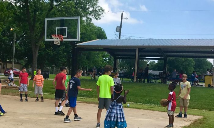 Mom's heart melts when older kids at basketball court invite shy son to join them