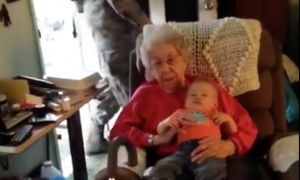Grandma on the couch with grandson when who walks in behind them—it means the world to her