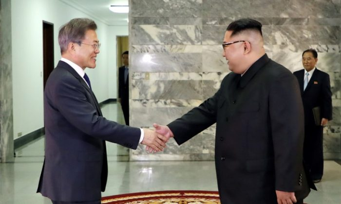 South Korean President Moon Jae-in is greeted by North Korean leader Kim Jong Un during their summit at the truce village of Panmunjom, North Korea, in this handout picture provided by the Presidential Blue House on May 26, 2018. (The Presidential Blue House /Handout via Reuters)