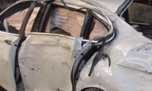 BMW looks smashed up and beyond repair, but what they do with it—I had to look again