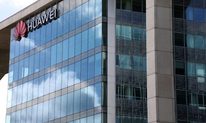 A picture taken on Sept. 4, 2017, in Boulogne-Billancourt, a neighboring suburb of Paris, shows a view of the headquarters of Hewlett-Packard (HP) Company and Chinese multinational networking and telecommunications equipment and services company Huawei. (Ludovic Marin/AFP/Getty Images)