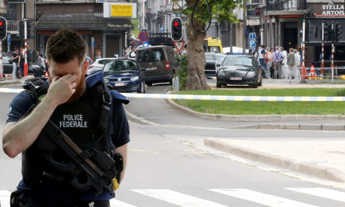 A police officer is seen on the scene of a shooting in Liege, Belgium, May 29, 2018. (Reuters/Francois Lenoir)