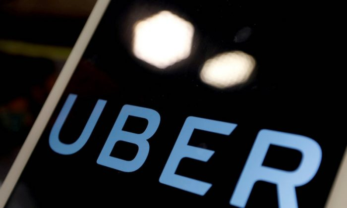 The logo of Uber is seen on an iPad, during a news conference to announce Uber resumes ride-hailing service, in Taipei, Taiwan April 13, 2017. (Reuters/Tyrone Siu/File Photo)