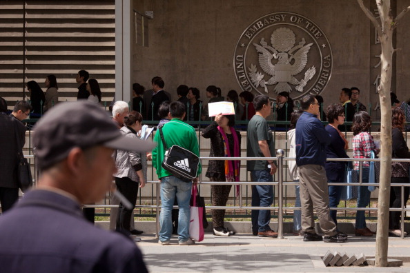 People queue outside the visa section of the U.S. embassy in Beijing on April 27, 2012. (Ed Jones/AFP/Getty Images)