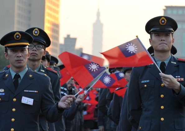 Participants wave the Taiwan's flag during a flag-raising ceremony at the Presidential Office Square in Taipei on Jan, 1, 2014. (Mandy Cheng/AFP/Getty Images)