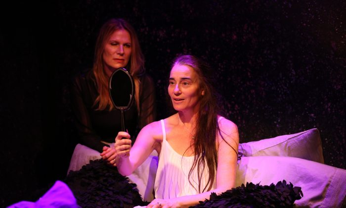 """Stephanie Roth Haberle (L) as Woman and Pamela J. Gray as Scarecrow, in Marina Carr's """"Woman and Scarecrow,"""" at Irish Repertory Theatre. (Carol Rosegg)"""