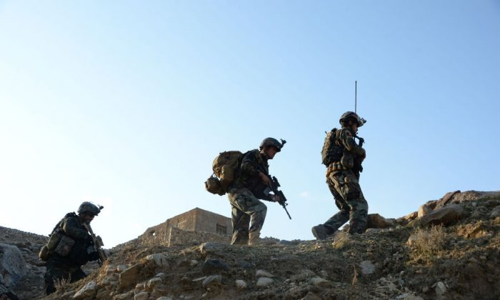 Afghan commandos forces patrol during ongoing US-Afghan military operation against ISIS militants in Achin district of Nangarhar province on Jan. 3, 2018. (Noorullah Shirzada/AFP/Getty Images)