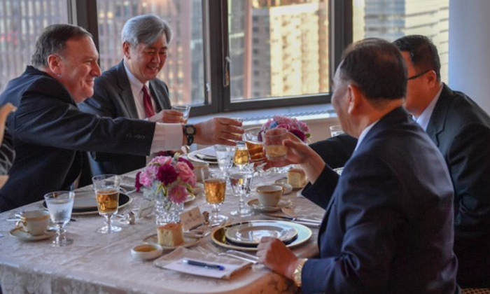 Secretary of State Mike Pompeo (L) toasts with North Korea's vice chairman, Kim Yong Chol, at a dinner in New York City on May 30, 2018. (Public Domain)
