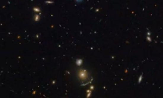 NASA's Hubble Telescope Finds a Green Cosmic Arc