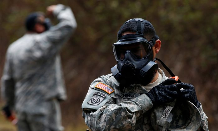 Sgt. Gavin Ching (R) of the Hawaii National Guard monitors sulfur dioxide gas levels in Leilani Estates during ongoing eruptions of the Kilauea Volcano in Hawaii, U.S., June 3, 2018.  (Reuters/Terray Sylvester)