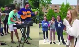 He wants to ask this girl to prom, but the song he chooses—the hint is on his t-shirt