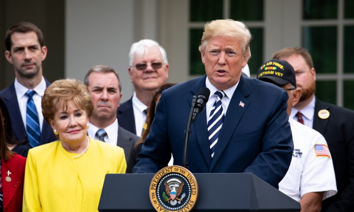 President Donald Trump participates in the signing ceremony for the VA Mission Act of 2018 in the Rose Garden of the White House in Washington on June 6, 2018. (Samira Bouaou/The Epoch Times)