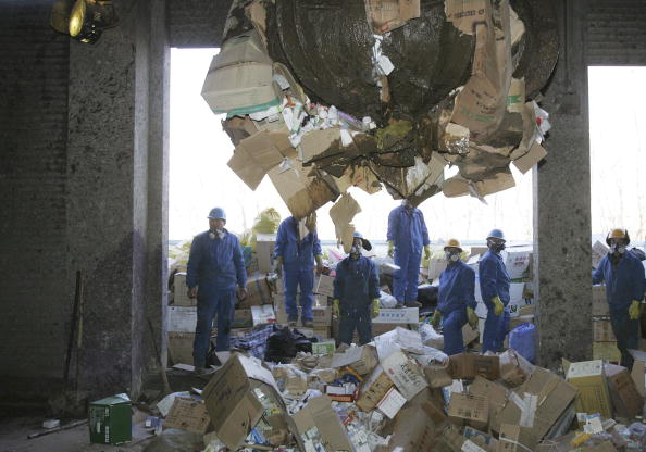 Workers destroy fake and outdated drugs in Beijing on Jan. 18, 2007. (China Photos/Getty Images)