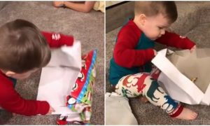Boy is opening his Christmas gift, his reaction is so over the top—but then I see the gift