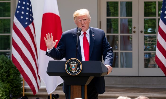 President Donald Trumps and the Prime Minister of Japan, Shinzō Abe, hold a joint press conference in the Rose Garden of the White House on June 7, 2018. (Samira Bouaou/The Epoch Times)