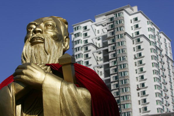 A statue of Confucius is seen with high-rise buildings in the background in Changchun of Jilin Province, China. (China Photos/Getty Images)