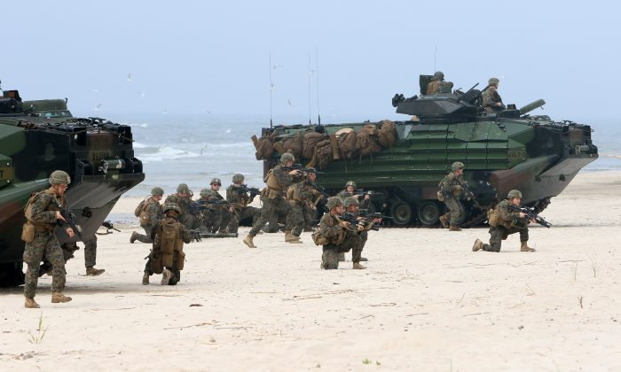 U.S. soldiers take part in a massive amphibious landing during the Exercise Baltic Operations (BALTOPS), a NATO maritime-focused military multinational exercise, on June 4, 2018 in Nemirseta on the Baltic Sea in Lithuania. (PETRAS MALUKAS/AFP/Getty Images)
