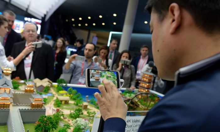 Visitors test models of ZTE smartphones at the Mobile World Congress in Barcelona on Feb. 22, 2016. (JOSEP LAGO/AFP/Getty Images)