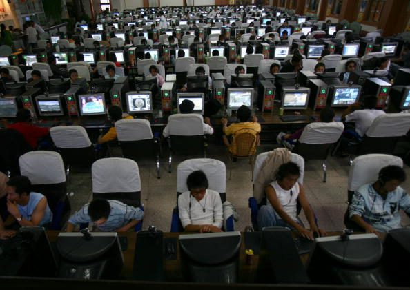 People surf the net at an internet cafe in Lhasa of Tibet Autonomous Region, China on Aug. 30, 2006. (China Photos/Getty Images)