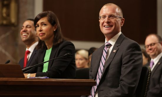 (L-R) Federal Communications Commission Chairman Ajit Pai, and nominees Jessica Rosenworcel, and Brendan Carr testify during their confirmation hearing in Washington, D.C., on July 19, 2017. (Chip Somodevilla/Getty Images)