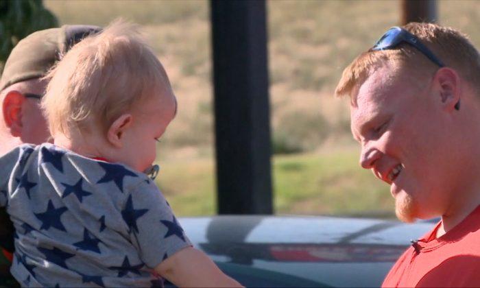 Jon Province reunites with the baby whose life he saved. (Screenshot via KDVR)