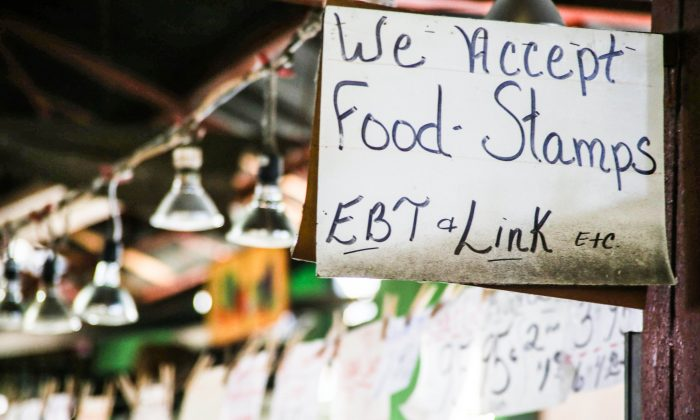 """A store accepting food stamps. (""""We Accept Food Stamps"""" by Paul Sableman/Flickr [CC BY 2.0 (ept.ms/2haHp2Y)])"""