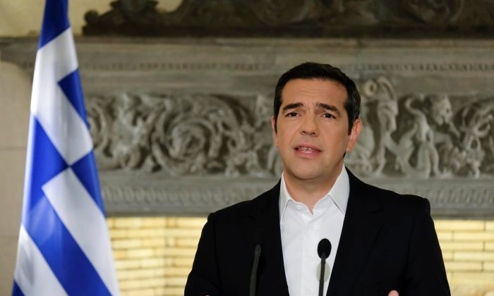 Greek Prime Minister Alexis Tsipras addresses the nation from his office in Maximos Mansion in Athens, Greece, June 12, 2018. (Andrea Bonetti/Greek Prime Minister's Office/Handout via Reuters)