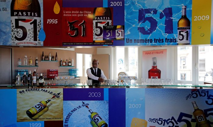 """A barman of French drinks maker Pernod Ricard group prepares drinks for clients at the """"Club Pernod"""" in Marseille, France, on April 27, 2016. (Jean-Paul Pelissier/Reuters)"""