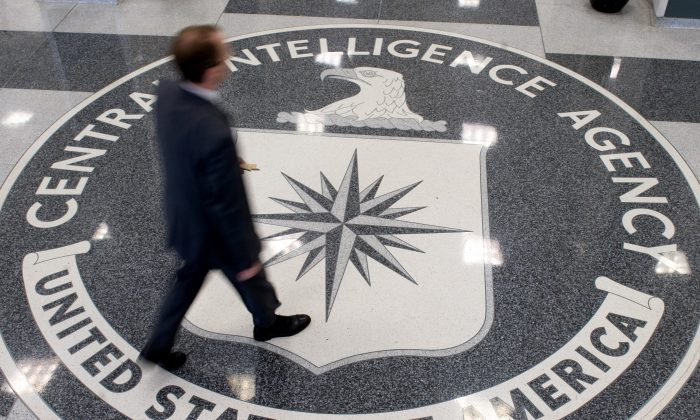 A man crosses the Central Intelligence Agency (CIA) seal in the lobby of CIA headquarters in Langley, Virginia, on Aug. 14, 2008. (Saul Loeb/AFP/Getty Images)
