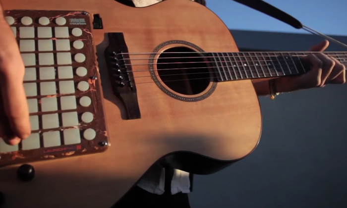 He's using what's called a 'hybrid guitar' and it sounds like nothing you've heard before