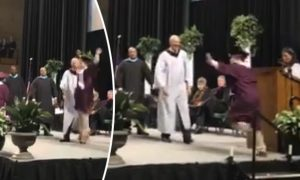 Teenager With Down Syndrome Jumps for Joy at High School Graduation