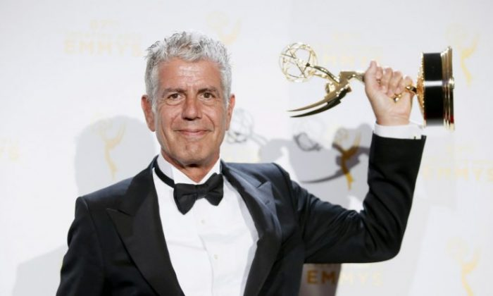 """Anthony Bourdain poses with the outstanding informational series or special award for """"Anthony Bourdain Parts Unknown"""" backstage at the 2015 Creative Arts Emmy Awards in Los Angeles, Calif., on Sept. 12, 2015. (REUTERS/Danny Moloshok/File Photo)"""