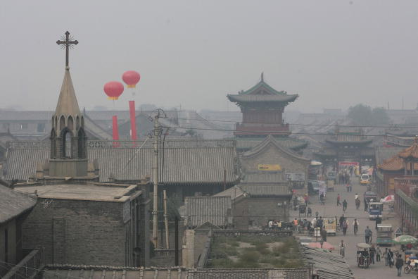 Tourists visit Pingyao, a city in Shanxi Province on Sept. 18, 2006. (China Photos/Getty Images)
