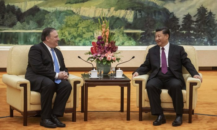 Secretary of State Mike Pompeo (L) speaks with China's President Xi Jinping during a meeting at the Great Hall of the People in Beijing on June 14, 2018. (Fred Dufour/AFP/Getty Images)
