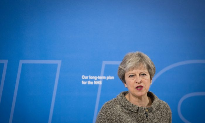 British Prime Minister Theresa May speaks at the Royal Free Hospital, London, on June 18, 2018.  (Stefan Rousseau/Pool via Reuters)