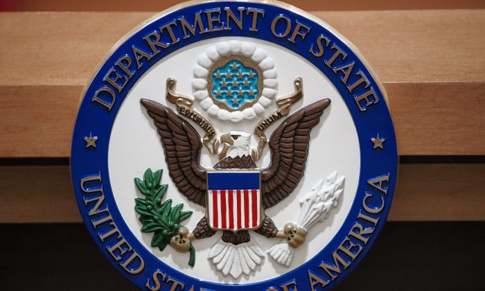 The US Department of State seal is seen on the podium-lectern area in the State Department briefing room in Washington in a 2013 file photo. (PAUL J. RICHARDS/AFP/Getty Images)