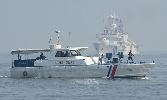 Philippine and Japanese coast guard personnel conduct joint anti-piracy exercises in the waters off Manila Bay on July 13, 2016.