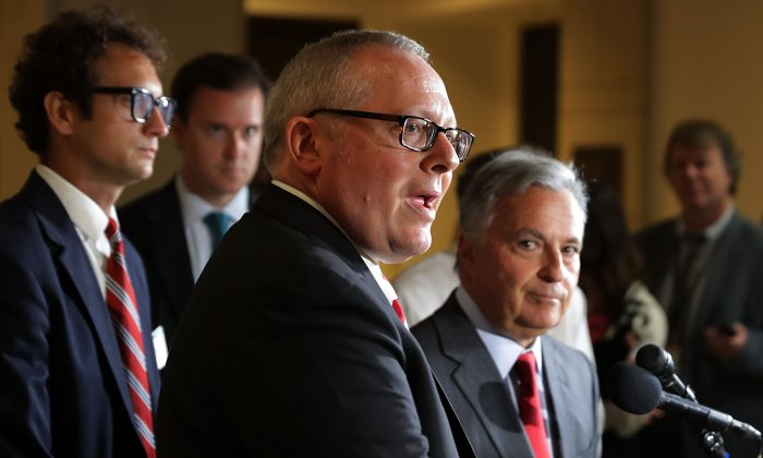 Former Trump campaign aide Michael Caputo (C) and his lawyer Dennis Vacco (R) after testifying before the House Intelligence Committee at the U.S. Capitol in Washington on July 14, 2017. (Chip Somodevilla/Getty Images)