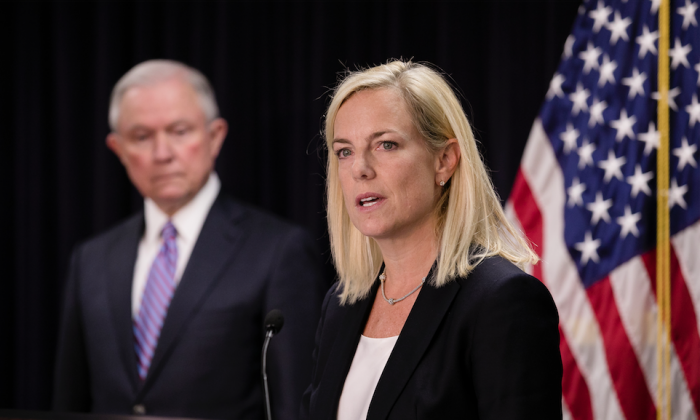 Department of Homeland Security Secretary Kirstjen Nielsen and Attorney General Jeff Sessions at a press conference in Baltimore, Md., on Dec. 12, 2017. (Samira Bouaou/The Epoch Times)