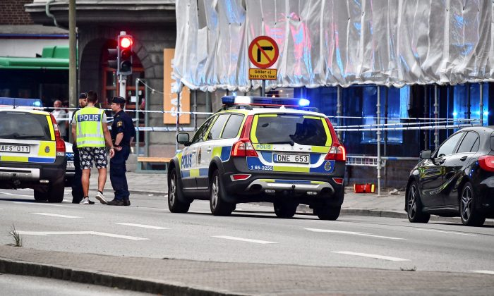Police stand next to a cordon after a shooting on a street in central Malmo, Sweden June 18, 2018. (TT News Agency/Johan Nilsson/via Reuters)